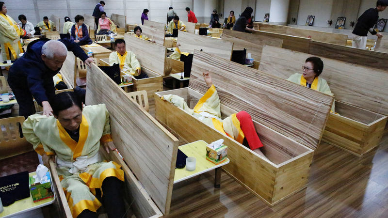 Dying for a better life: South Koreans fake their funerals for life Courses