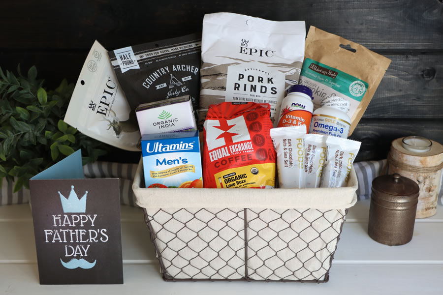 A Father's Day Gift Basket with snacks, coffee and health foods