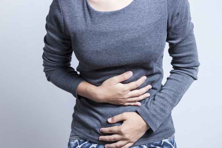 functional dyspepsia woman with a stomach ache