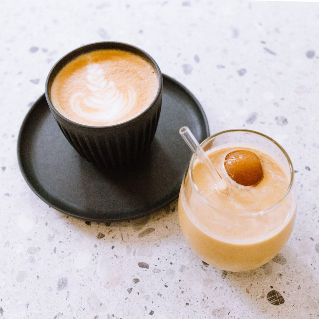 A double ristretto shot of Yunnan Ouyang coffee with an Earl Grey ice ball topped with milk