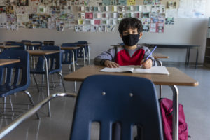 Child wearing a mask at school