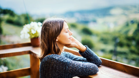 young woman with persistent illness relaxing outdoors