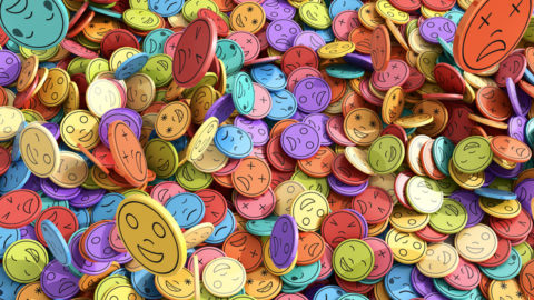 An abstract of many multicolored emoji discs showing different emotions
