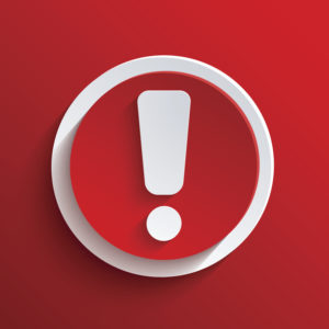White exclamation mark on a red background;  danger concept