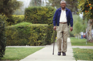 Man walking with cane in the park