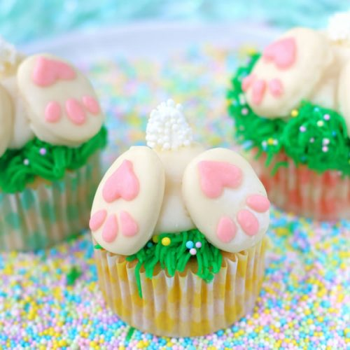 three bunny butt cupcakes on sprinkles