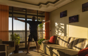 Man doing jumps while exercising at home