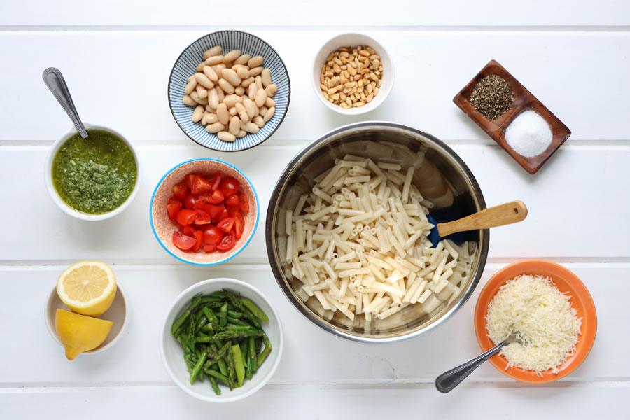 tomatoes, cannellini beans, pine nuts, parmesan cheese, lemon, asparagus, Ingredients laid out for the chicken pesto pasta